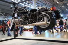Motorcycle Ural M-70 Retro black with stroller. Installation on cables at indoor exibition royalty free stock photos