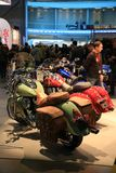 Motorcycles Indian stand at the exhibition in row. Side view Royalty Free Stock Photography
