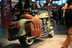 Steel and leather. Motorcycle Indian Chief Vintage 2017 willow green / ivory cream Stock Photos