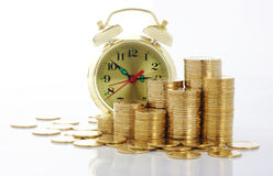 Free Time Is Money - Clock Dial And Golden Coins Royalty Free Stock Photo - 12043315