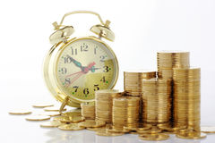 Free Time Is Money - Clock Dial And Golden Coins Stock Images - 12131004