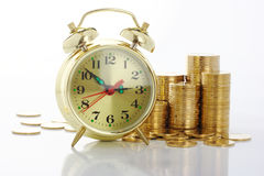 Free Time Is Money - Clock Dial And Golden Coins Stock Photos - 12221183