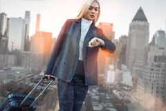 Free Time Is Money. Confident Business Woman In Classic Wear Checking The Time While Standing Against Of Modern Office Royalty Free Stock Image - 140597996