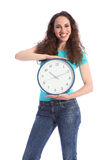 Time keeping beautiful young woman holding clock Stock Photo