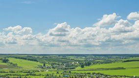 Time laps over a beautiful summer landscape, camera shift in space.  stock footage