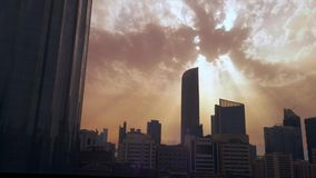 Time lapse of Abu Dhabi city skyscrapers and skyline at sunset on a cloudy day.  stock footage