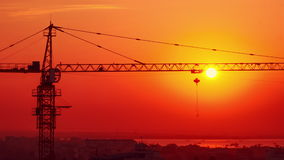 Time lapse aerial cityscape view of crane sunrise silhouette at building construction. Yangon, Myanmar stock video