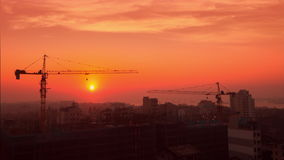 Time lapse aerial cityscape view of crane sunrise silhouette at building construction. Yangon, Myanmar stock video footage