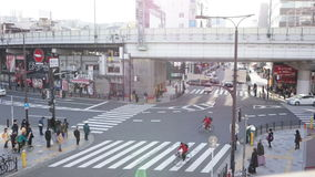 Time Lapse, Aerial View of Pedestrians Crossing Crosswalk Cars Traffic in Japan stock video footage