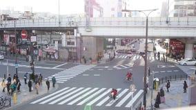 Time Lapse, Aerial View of Pedestrians Crossing Crosswalk Cars Traffic in Japan. OSAKA, JAPAN - MARCH 2015: -Time Lapse, Aerial View of Pedestrians Crossing stock video footage