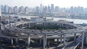 Time lapse,Aerial view of urban overpass traffic interchange. Time lapse,Aerial freeway busy city rush hour heavy traffic jam highway Shanghai china,nanpu stock video