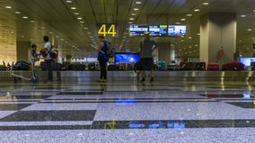 Time lapse Airport baggage claim with luggage spinning around conveyor. Belt stock footage