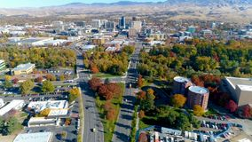Time lapse along Capital boulevard with clock tower of the train depot. Fast motion of cars traveling on main street in Boise Idaho Aerial view stock footage