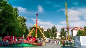 Time lapse. Amusement rides with fun people in the park of the bitter city of Rostov on Don