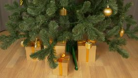 Time lapse. Appearing gift boxes under christmas tree. Red white and brown color gift box. Green christmas tree at home stock video footage