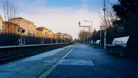 Time lapse. Arriving by train at the station. London. England. United Kingdom. 10 December 2016. Against the background of the beautiful sky and yellow trees in stock video footage