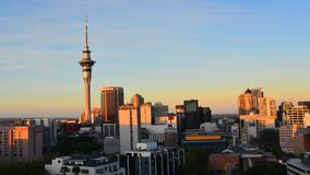 Time lapse of Auckland downtown skyline during sunset stock video footage