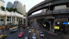 Time lapse of Bangkok busy streets in the evening. BANGKOK, THAILAND - MAY 19: Time lapse of Bangkok busy streets in the evening on May 19, 2014 in Bangkok stock video footage