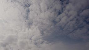 Time lapse of banks of cirrocumuli white clouds blowing with shadows and crosses each others. Enveloping time lapse of banks of cirrocumuli white clouds blowing stock video