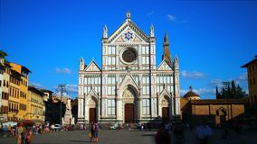 Time lapse of basilica of Santa Croce, Florence. Florence, October 2017: Time lapse of tourists admire the facade of the Basilica of Santa Croce from the square stock footage