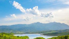 Beautiful crystal mountain lake, green meadow hill stock video footage