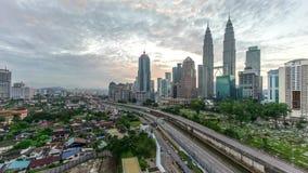 Time lapse. Beautiful dramatic sunrise at Kuala Lumpur city skyline. 4k time lapse of dramatic sunrise at Kuala Lumpur city. Moving and changing color clouds stock video