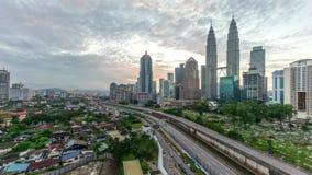 Time lapse. Beautiful dramatic sunrise at Kuala Lumpur city skyline. 4k time lapse of dramatic sunrise at Kuala Lumpur city. Moving and changing color clouds stock footage