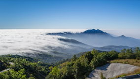 Time lapse beautiful mist flowing on valley. At doi inthanon national park of chiang mai, thailand stock video footage