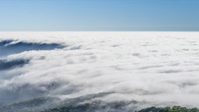Time lapse beautiful mist flowing on valley. At doi inthanon national park of chiang mai, thailand (pan shot stock video footage