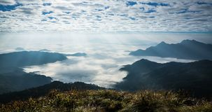 Time lapse of beautiful sun rays shining upon the mountainous landscape at Phu Chi Fah national Park. stock footage