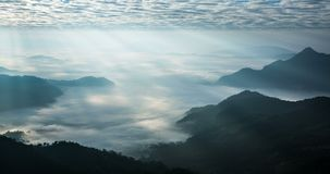 Time lapse of beautiful sun rays shining upon the natural landscape at Phu Chi Fah national Park. Located at Chiang Rai province, Thailand stock footage