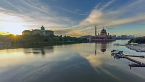 Time lapse. Beautiful Sunrise At Putra Mosque, Putrajaya. Showing a moving and changing color clouds. stock video footage