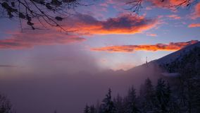 Sunset time lapse of snowy Alps. Sunset view time lapse of snowy Alps with fog and clouds, in Italy stock video