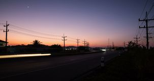 Time lapse of a beautiful twilight filmed from a roadside of a countryside, Chiang Rai province. stock video footage