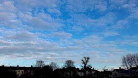 Time lapse. Beautiful and volumetric clouds slowly float across the sky. stock footage
