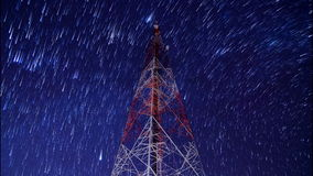 Time lapse big communication tower and beautiful startrails in night sky Stock Images