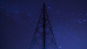 Time lapse big communication tower and starry in night sky Royalty Free Stock Photos