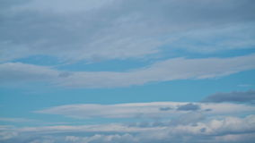 Time lapse of blue sky with creation of big white cloud stock footage