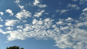 Time Lapse of Blue sky with white clouds in motion stock footage