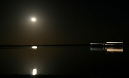 Time lapse boat saling under moon light. Royalty Free Stock Photo