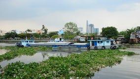 Time Lapse of Boat and Shacks on the Saigon River - Ho Chi Minh City (Saigon) stock footage