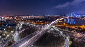 Time lapse of bridges and Cars passing in intersection, Han Riverside at Night in Downtown Seoul, South Korea. 4K