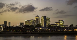 Time lapse of buildings in the Docklands financial district in London. Sunset with transition to night stock footage