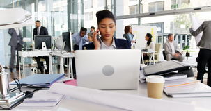 Time-lapse of businesswoman having coffee while working at desk. In office stock video