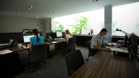 Time lapse of busy city office workers working in office