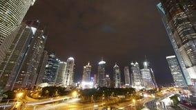 Timelapse,urban traffic & walking people silhouette at night,modern skyscraper. Time lapse,busy city traffic & walking people silhouette,brightly lit urban stock video