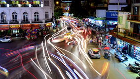 Time Lapse of Busy Downtown Traffic Circle at Night -  Hoan Kiem Lake / Hanoi Vietnam. Busy Downtown Hanoi Vietnam at Night stock footage