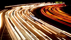 Time Lapse of Busy Freeway Traffic at Night - 4K stock video