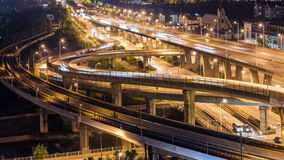 Time lapse of the busy interchange traffic at night in city stock video