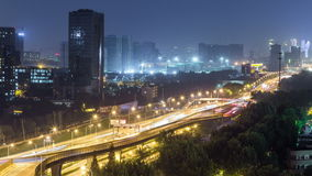 Time lapse of the busy interchange traffic at night in city stock video footage